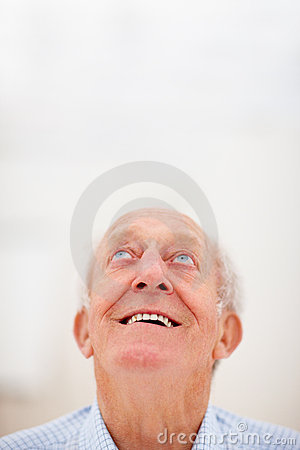 Closeup of an old man looking up at copyspace
