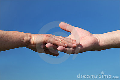 Closeup of old people holding for hands Stock Photo