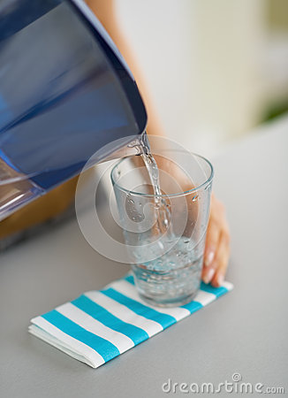 Free Closeup On Housewife Pouring Water Into Glass Royalty Free Stock Photos - 32838668