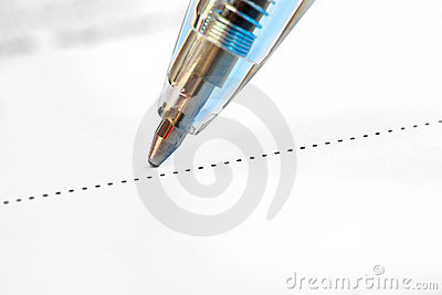 Closeup of a pen on the dotted line