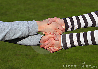 Closeup picture of shaking hands.