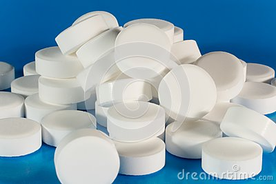 Closeup of a pile of white pills