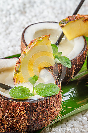 Closeup of pinacolada in a coconut