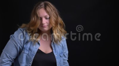 Closeup portrait of adult caucasian blonde female making funny dance moves in front of the camera.  stock footage