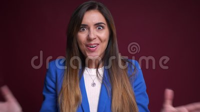 Closeup portrait of attractive caucasian female in formal clothing getting surprised and excited looking at camera.  stock video