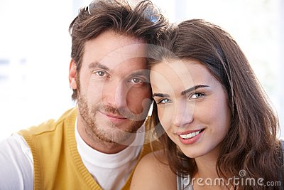Closeup portrait of attractive couple smiling