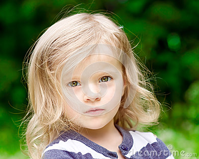 Closeup portrait of a beautiful blonde little girl