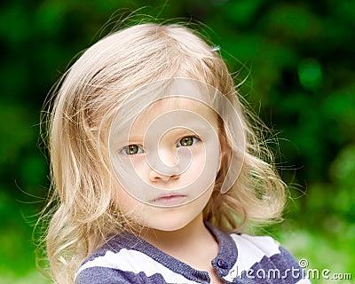 Closeup portrait of a beautiful blonde little girl