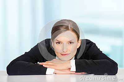 Closeup portrait of beautiful young woman over blue background