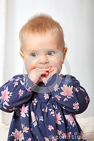 Closeup portrait of cute cheerful baby girl