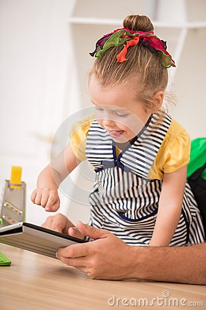 Closeup portrait of cute little girl with tablet