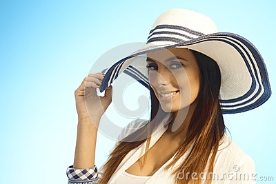 Closeup portrait of elegant woman in straw hat