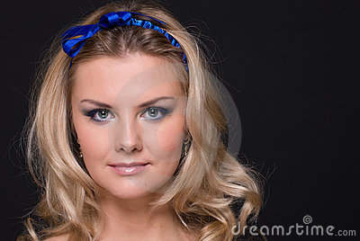 Closeup portrait of fashion woman with blue bow