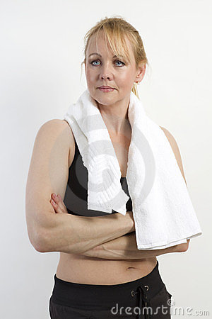 Closeup portrait of fit mature woman with a towel.