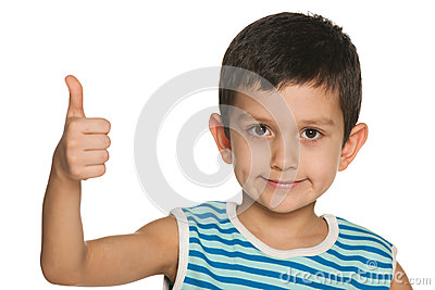 Closeup portrait of a boy holds his thumb up