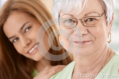 Closeup portrait of happy mother and daughter
