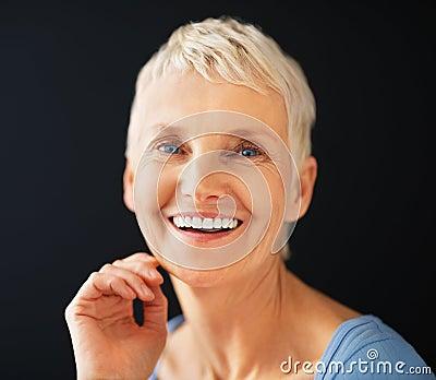 Closeup portrait of a happy senior woman