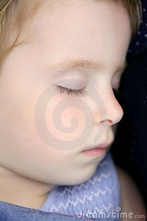 Closeup portrait of little blond child sleeping