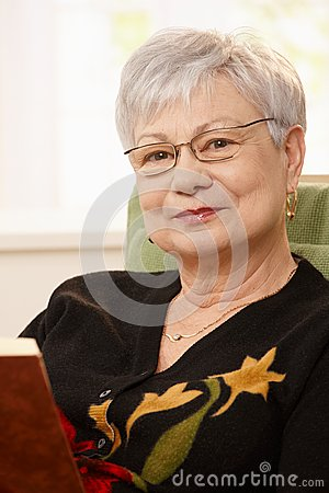 Closeup portrait of senior woman with book