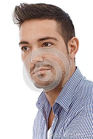 Closeup portrait of serious young man