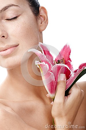 Closeup portrait of woman with lily