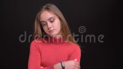Closeup portrait of young beautiful caucasian female being bored and awaiting for someone.  stock video footage