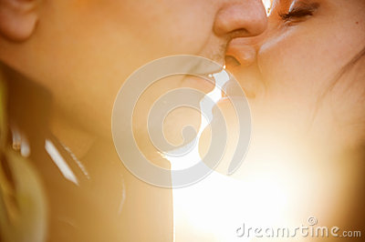 Closeup portrait of young kissing couple Stock Photo