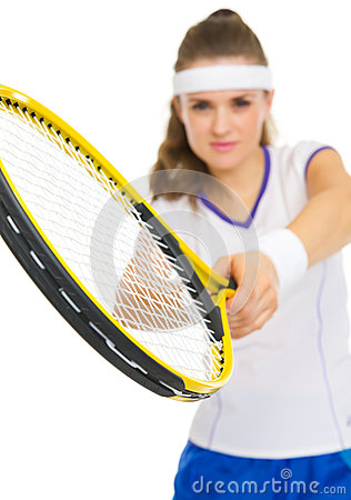 Closeup on racket in hand of tennis player