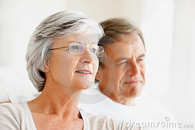 Closeup of a relaxed old couple looking away
