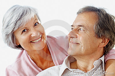 Closeup of a relaxed senior couple against white