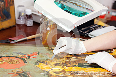 Closeup of  Restorer working on the old icon
