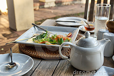 Closeup of salad dish n tea pot in restaurant