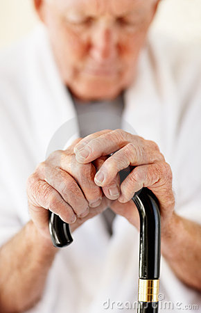 Closeup of a senior man holding a walking stick