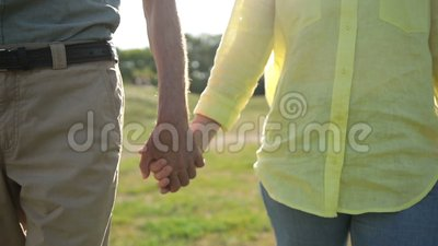 Closeup of seniors holding hands expressing love stock video footage