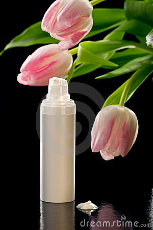 Closeup shot of  facial cream/lotion and tulips