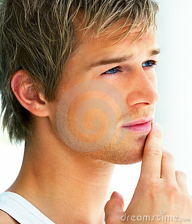 Closeup shot of a handsome young man looking away