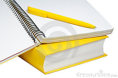 Closeup shot of  yellow book, copybook and pen