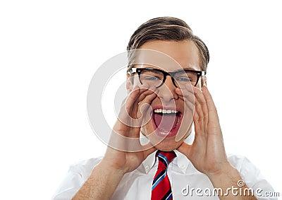 Closeup shot of a young man shouting loud
