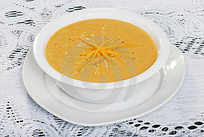 Closeup Of Shredded Cheddar Cheese Soup