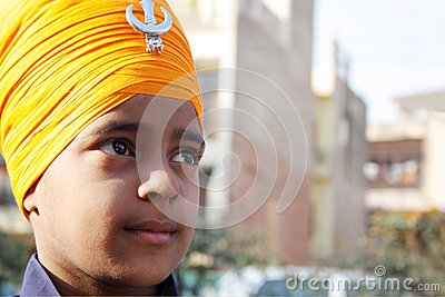Closeup of a sikh child with saffron turban Editorial Stock Image