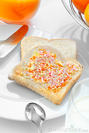 Closeup of a slice of bread with candies