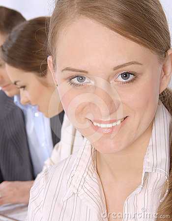 Closeup of a smiling young business woman