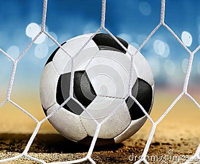 Ball on ground near goal-area