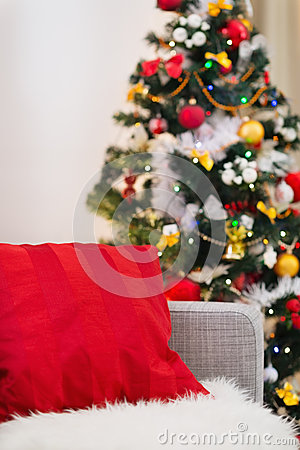 Closeup on sofa with pillow near Christmas tree