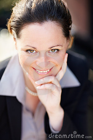 Closeup of a sweet mature business woman smiling
