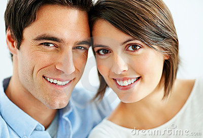 Closeup of a sweet young couple smiling together