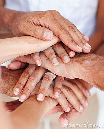 Closeup of a team of people s hands together