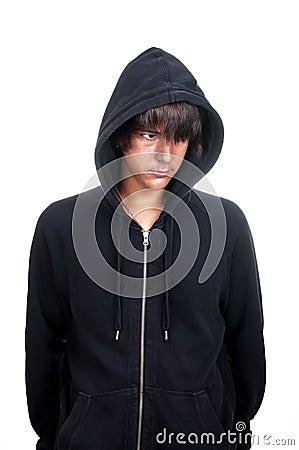 Closeup of a teenager wearing a hoodie, underlit