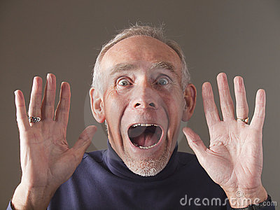 Closeup of terrified old man screaming