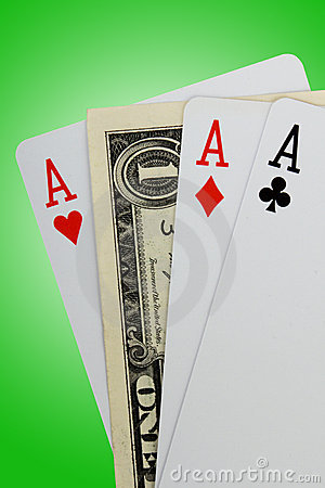 Closeup of three aces and one dollar note